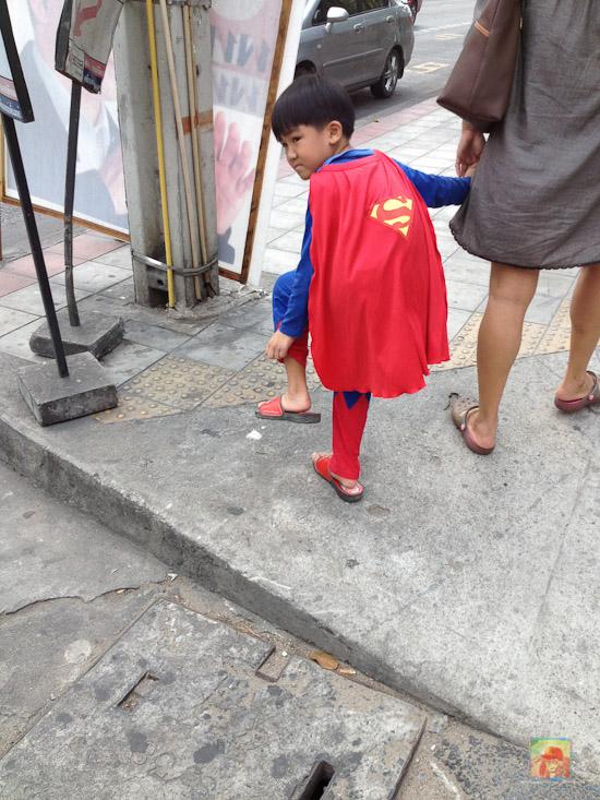 kid in superman costume