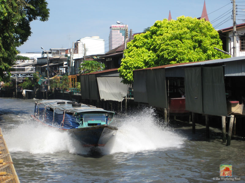 A passenger motorboat cutting across one of the canals in Bangkok...