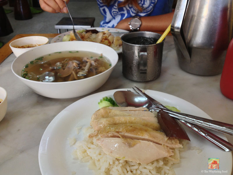 Two plates of Khao Man Gai (Chicken & Rice) with a bowl of chicken soup to share, only 80THB or $2.60USD...
