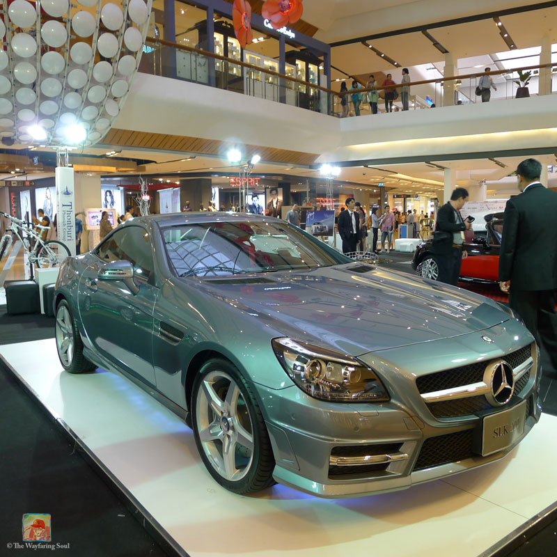 A lot of luxury cars are displayed in Bangkok's malls...