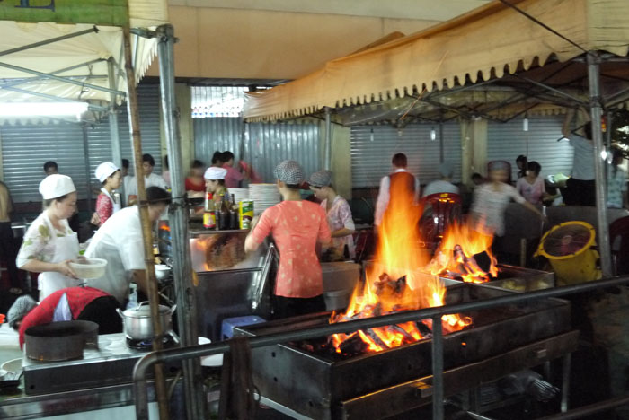 Fresh seafood grilled on open flames at Ben Thanh night market...
