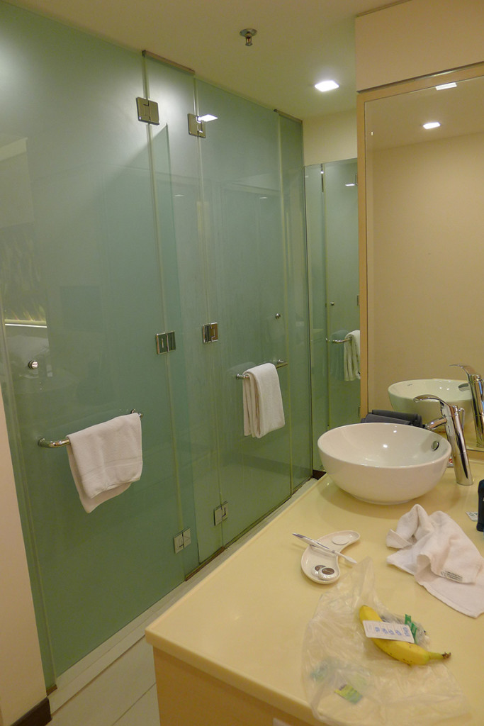 Toilet and shower stalls in room...