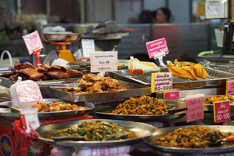 In Thailand, it could be a lot cheaper to buy food and take home than cooking...