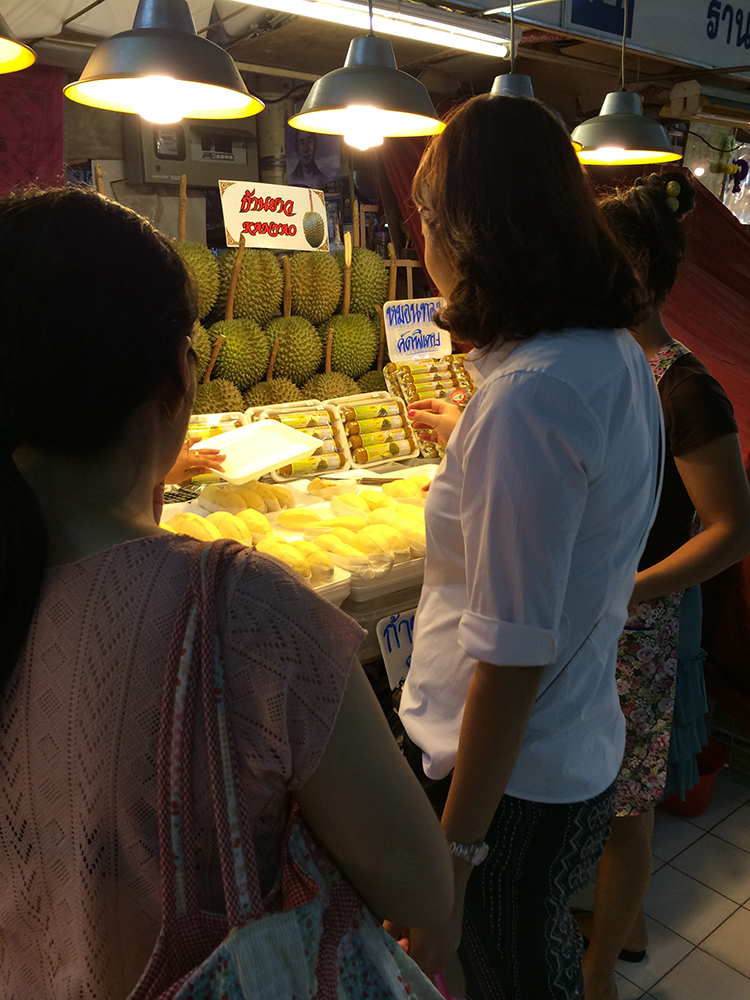 Wife buying some Kanyao durian. You can see the long stemmed durian in the background...