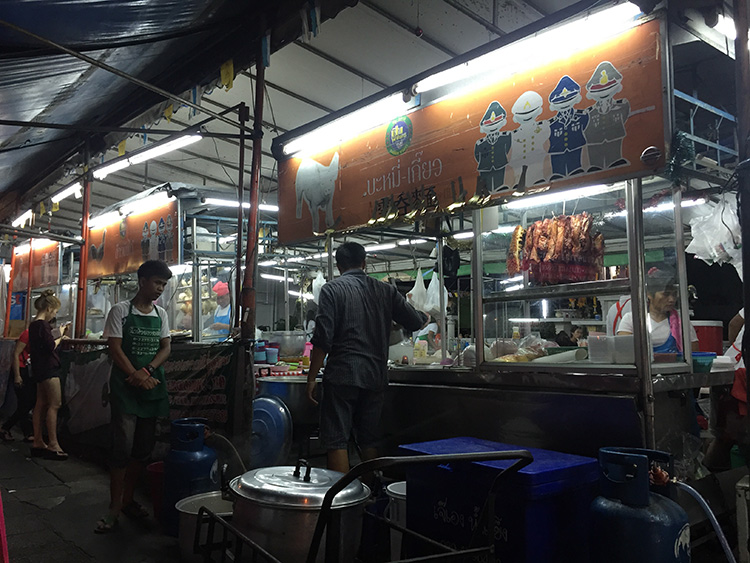 A simple shop with 4 carts serving popular Thai rice and noodle dishes...