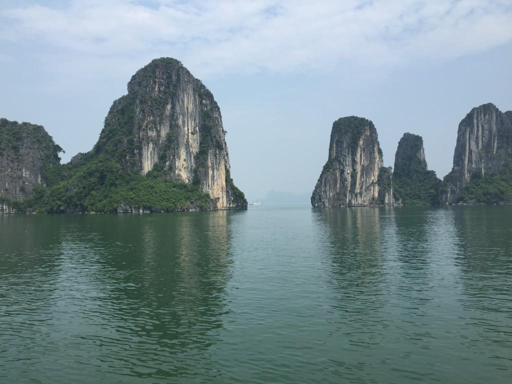Heading towards Halong Bay you'll see huge looming limestone cliffs...