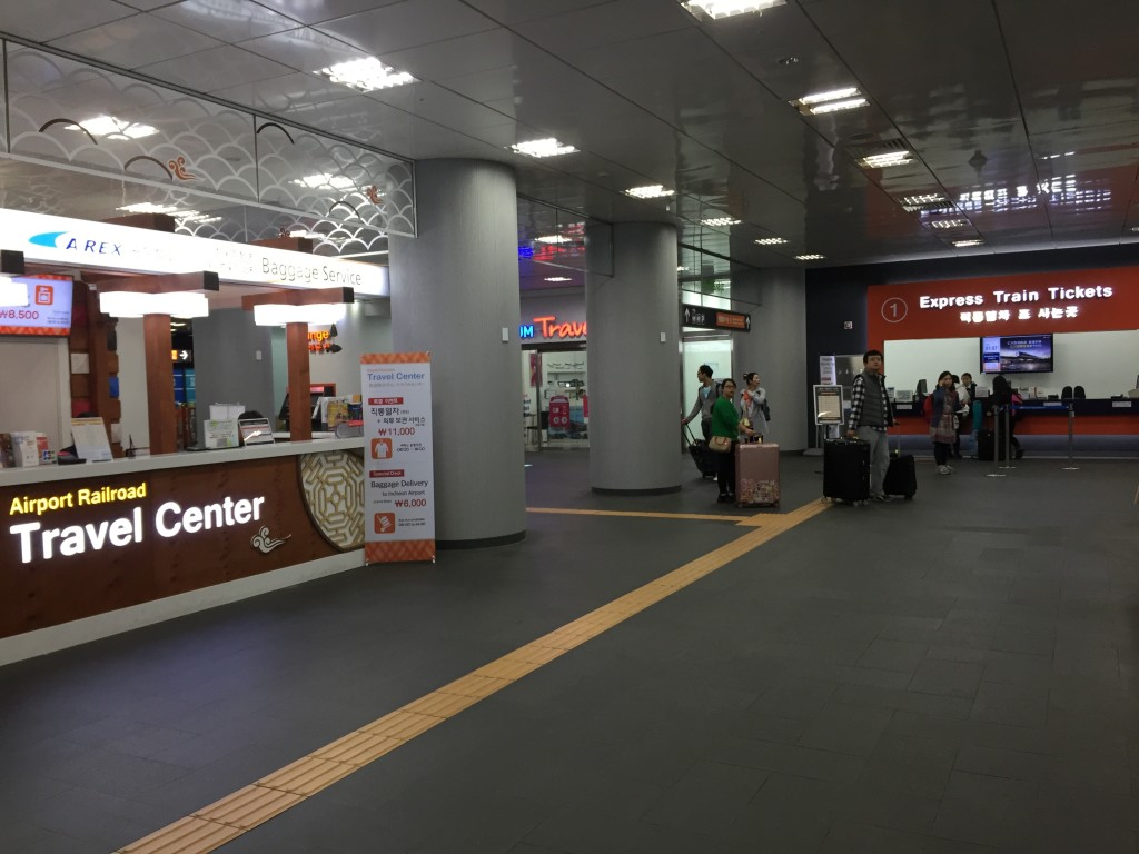 Here's where you can buy a fare going to Incheon Airport. Or you can use your T-Money card...