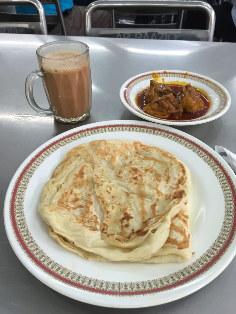Roti paratha, chicken curry and hot ginger tea with milk...