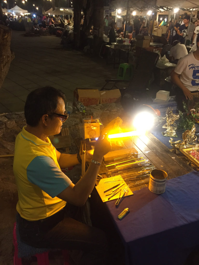 This guy is a master craftsman of glass figurines. His son is learning the art too...