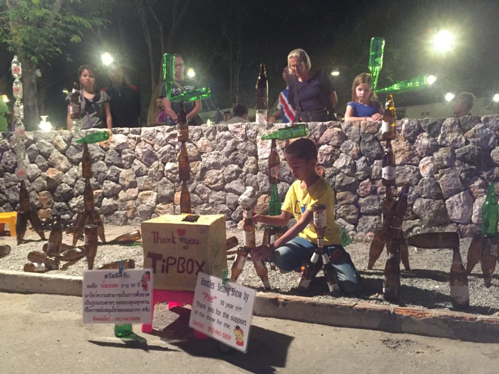 This kid is quite amazing with what he can do with empty bottles of beer...